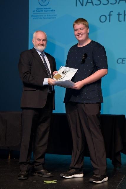 Jared Van Der Zee receiving his award
